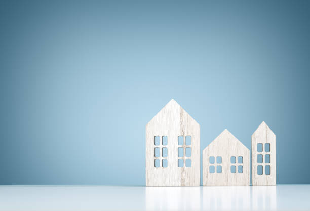 House real estate and construction background, wooden model houses stock photo