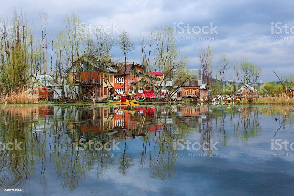 house reflection on water stock photo