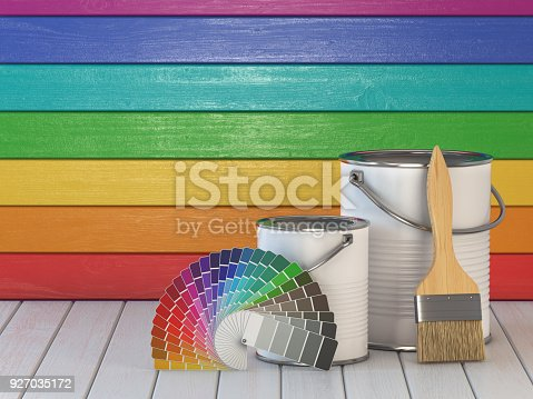 939851856 istock photo House renovation and improvement concept background. Paint cans, paint brush and color palette on wooden wall painted in a colors of the rainbow. 927035172