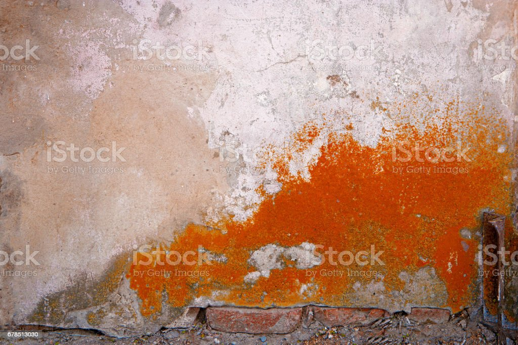 House renovaton concept. Old wall of building half painted in dark orange color stock photo