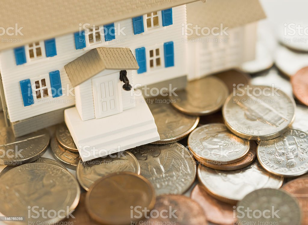House resting on money stock photo