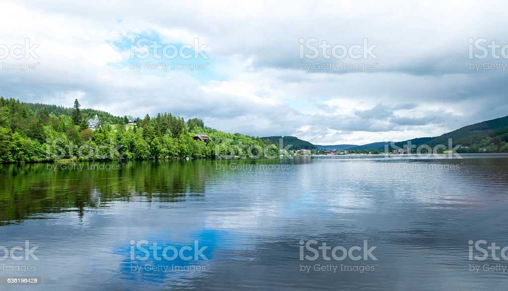 House roof behind forest nearby lake at Titisee-Neustadt, Germany. stock photo
