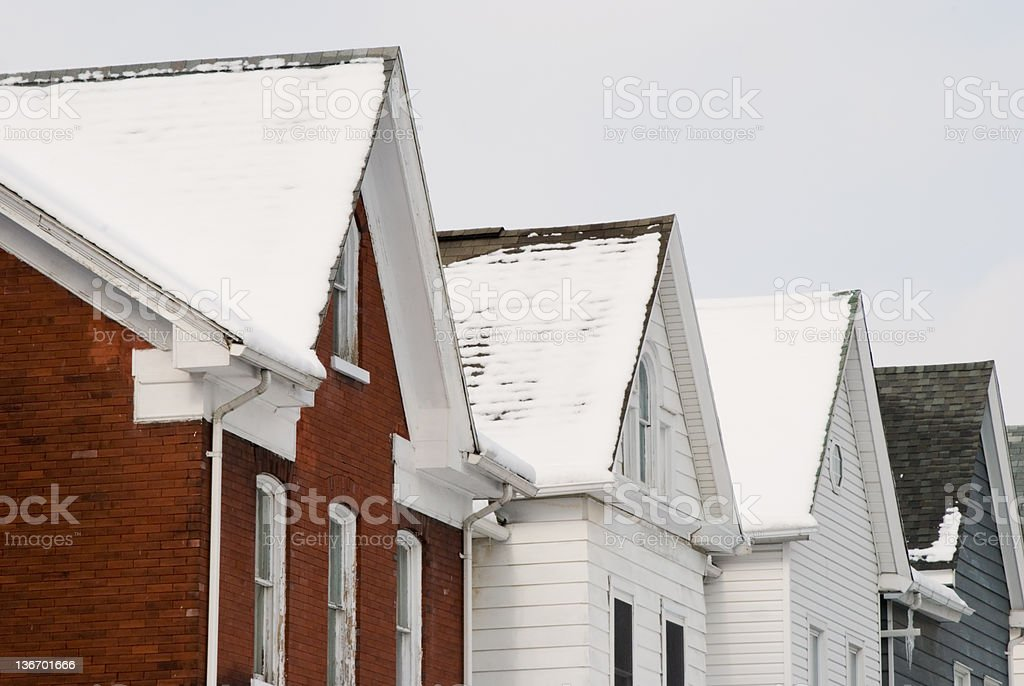 House Roofs in Snow, Winter Row Homes stock photo