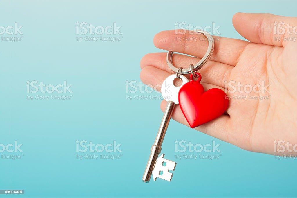 House shaped key with heart shape keyring stock photo