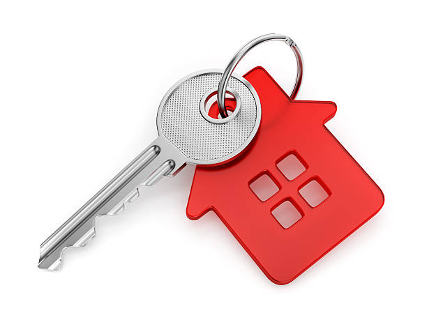 House shaped key-chain Metal door key with red house shaped key-chain isolated on white background buy single word stock pictures, royalty-free photos & images