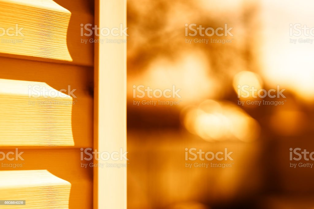 House siding sunset background stock photo
