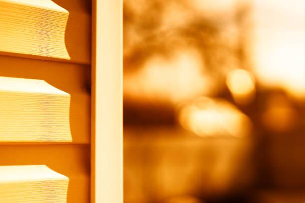 House siding sunset background stock photo