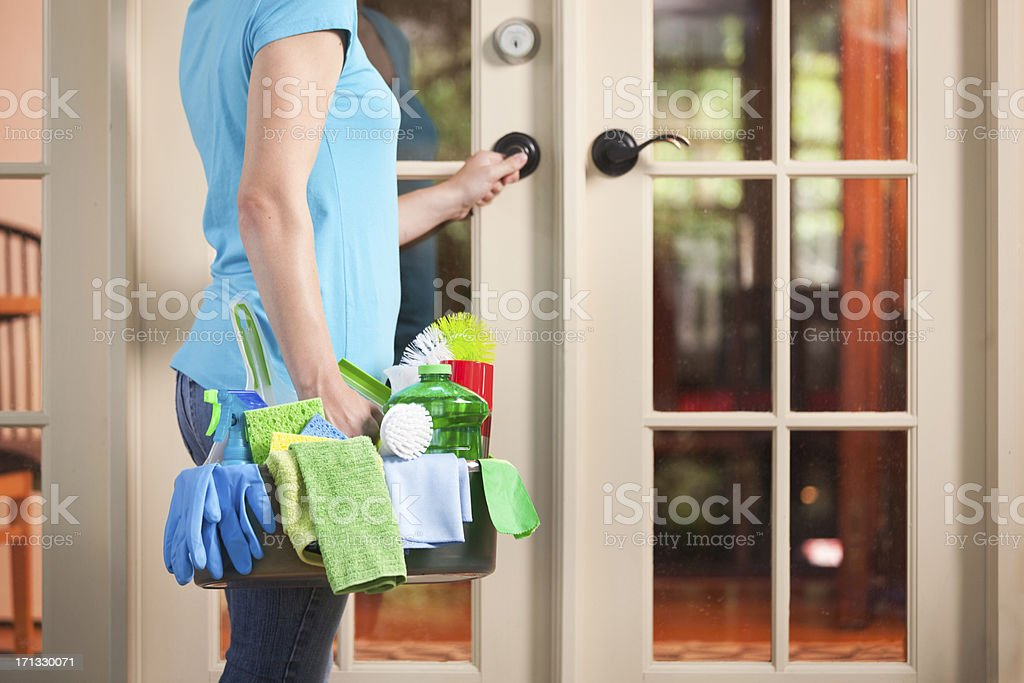 House Spring Cleaning Maid Housework Service, Cleaner Entering Home Door stock photo