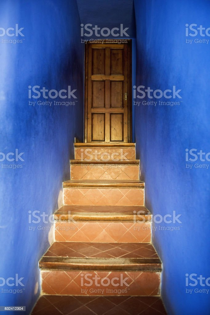 House stairs and wooden door in Park Guell, Barcelona stock photo