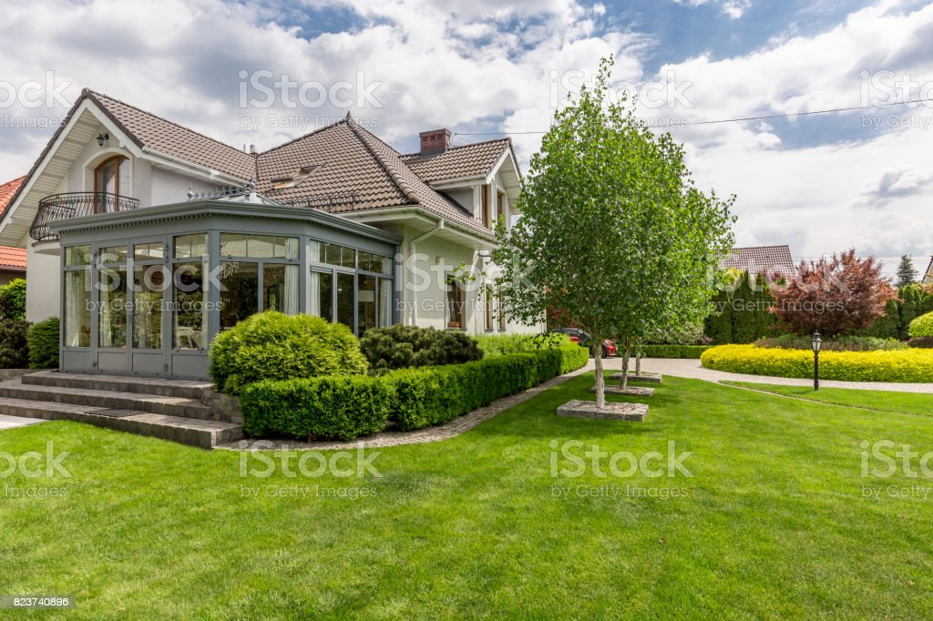 House surrounded by garden stock photo