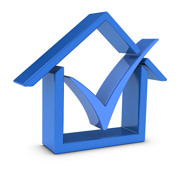 House Symbol and Check Mark stock photo