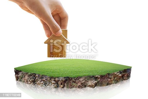 istock House symbol and Empty dry cracked swamp reclamation soil, land plot for housing construction project. 1192770249