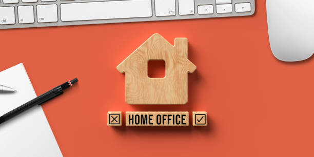 house symbol and wooden blocks with text HOME OFFICE stock photo
