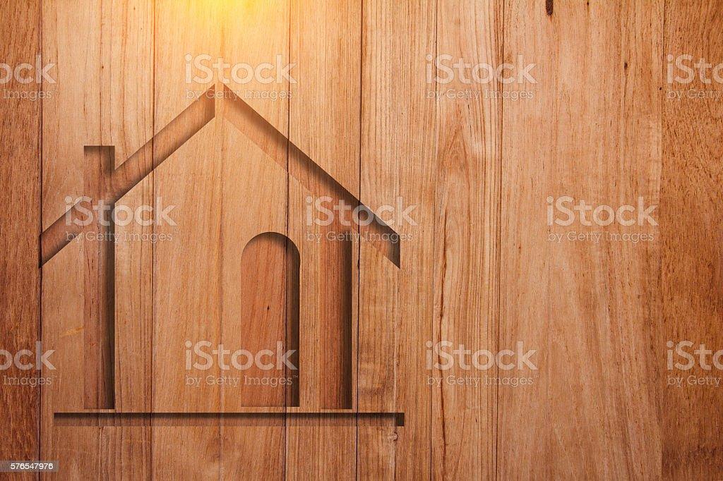 house symbol on wooden plank background stock photo