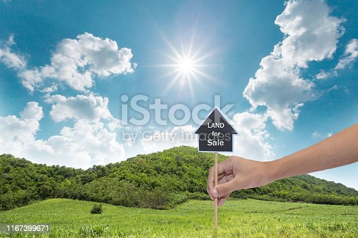 istock House symbol with location pin and Empty dry cracked swamp reclamation soil, 1167399671