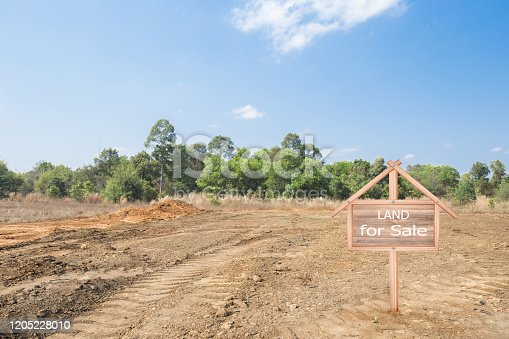 istock House symbol with location pin and Empty dry cracked swamp reclamation soil, 1205228010
