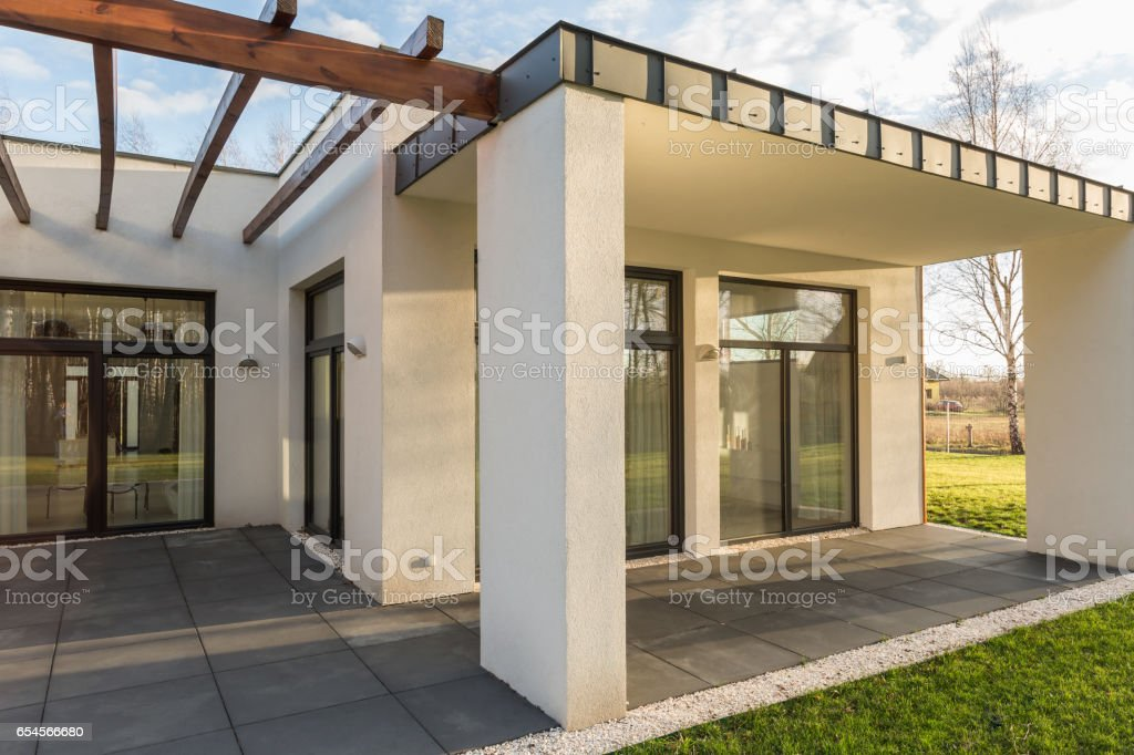 House terrace with pergola and garden stock photo