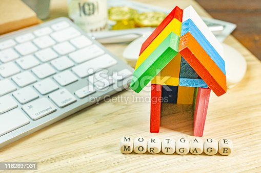 The house toy on office table for mortgage concept.