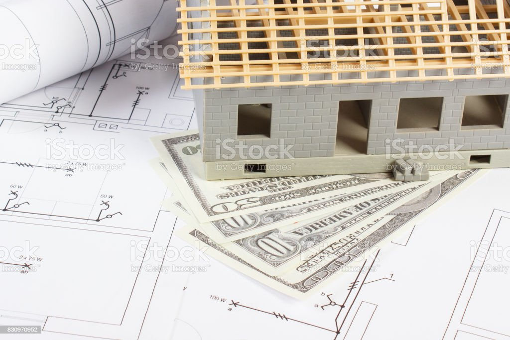 House Under Construction And Currencies Dollar On Electrical ...
