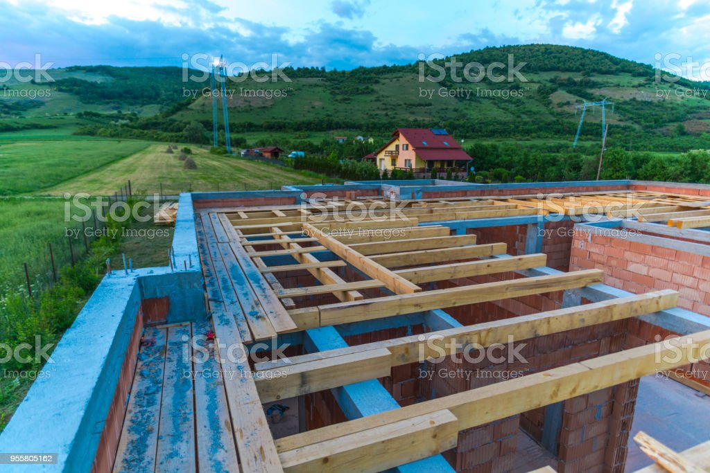House under construction at the evening stock photo