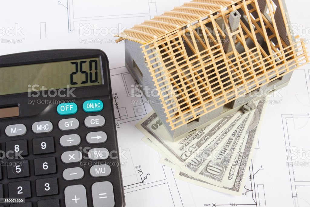 Nice House Construction Calculator #7: House Under Construction, Calculator And Currencies Dollar On Electrical  Drawings And Diagrams, Building Home