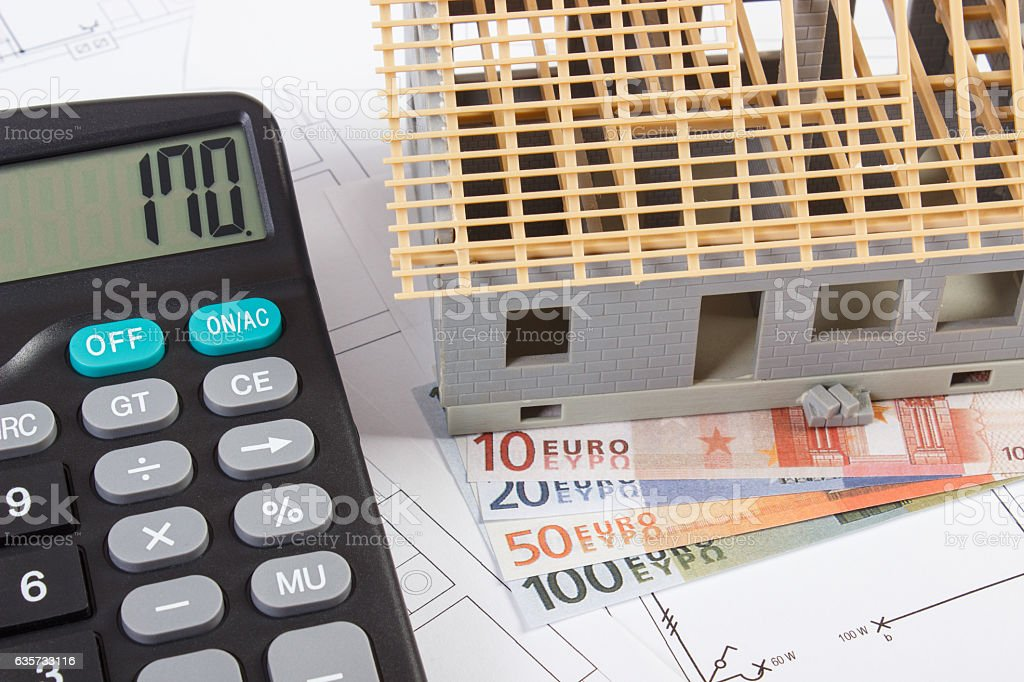 Wonderful House Construction Calculator #1: House Under Construction, Calculator And Currencies Euro On Electrical  Drawings Royalty-free Stock Photo