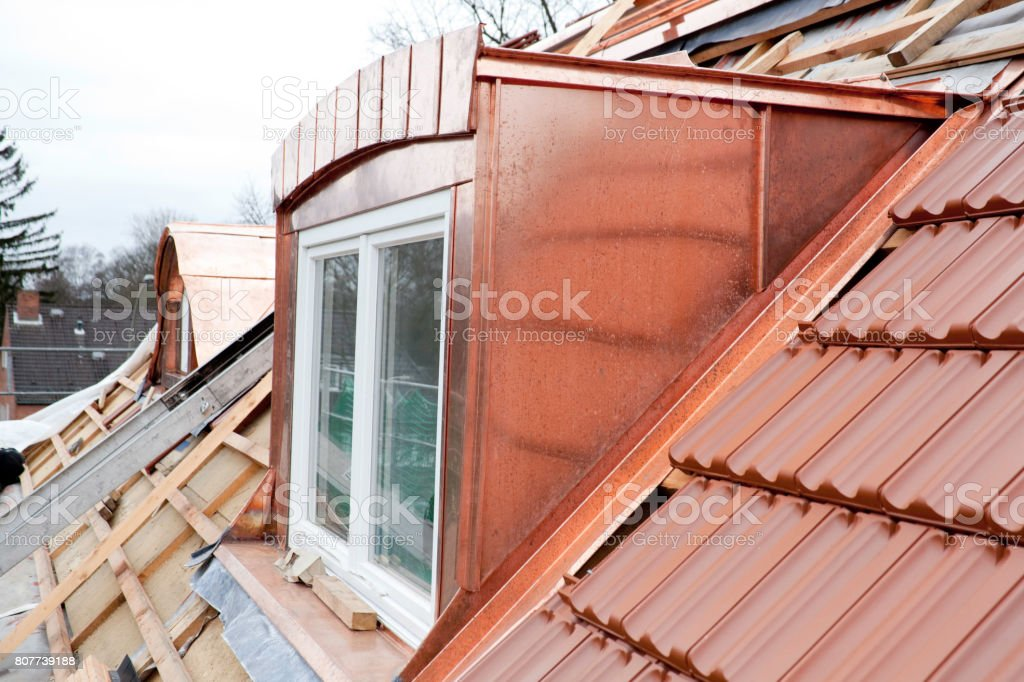 House under construction. New Roof and copper stock photo