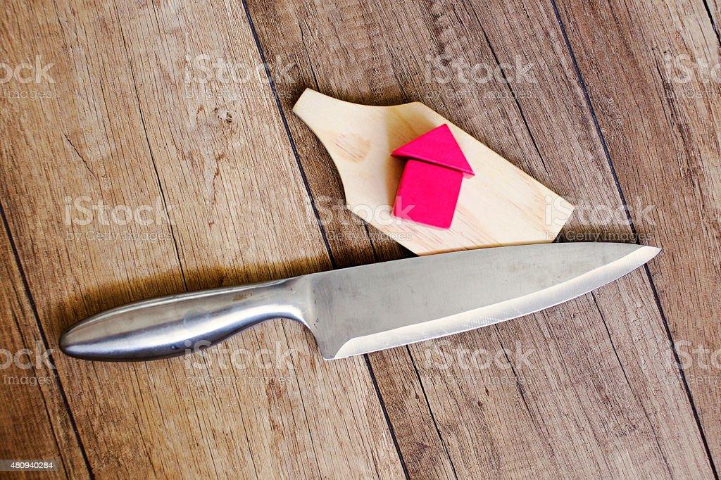 house under knife stock photo