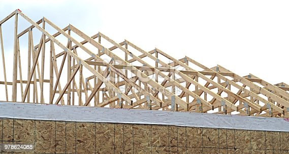 House under recently started construction with trusses