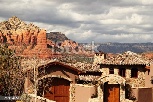 House with a view in Sedona, Arizona.  In the background is a red rock formation known as Coffee Pot.