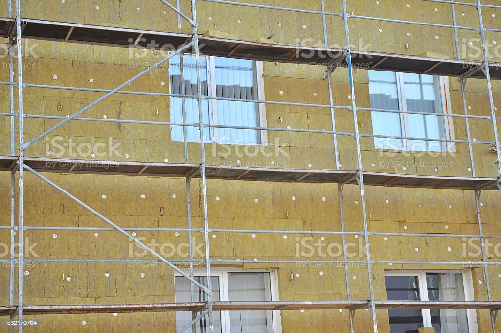 House wall heat isolation with mineral wool stock photo