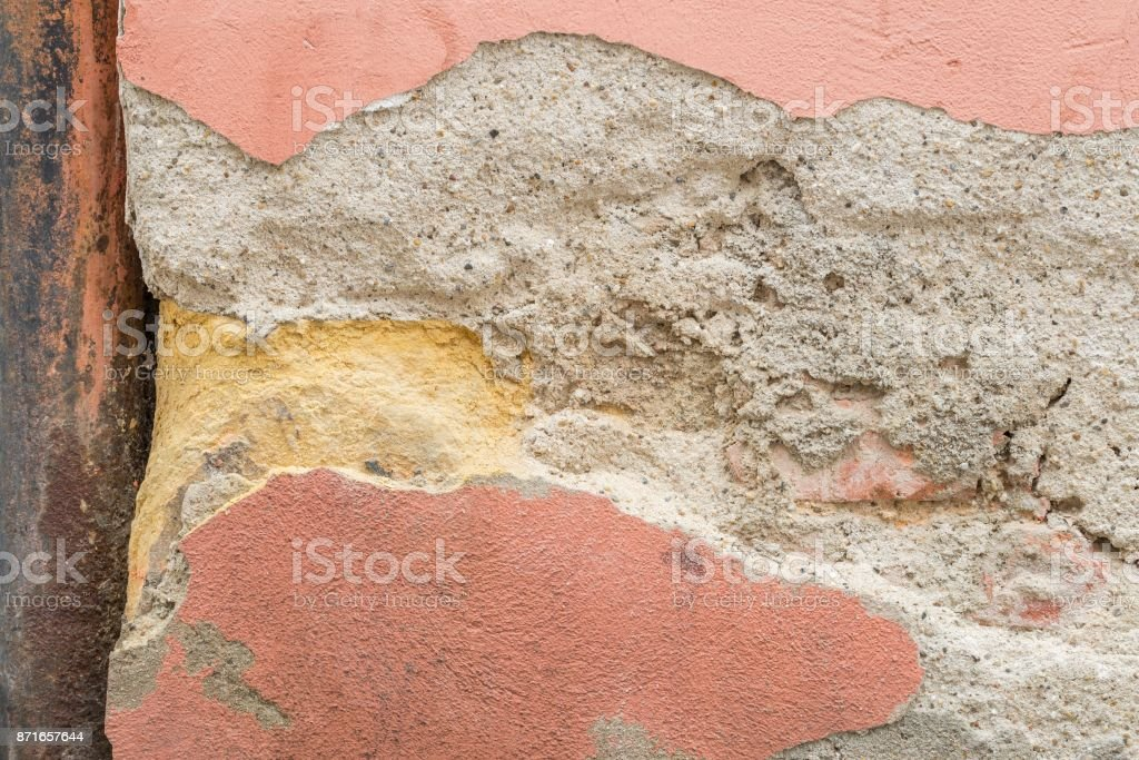 House wall with flaking plaster stock photo