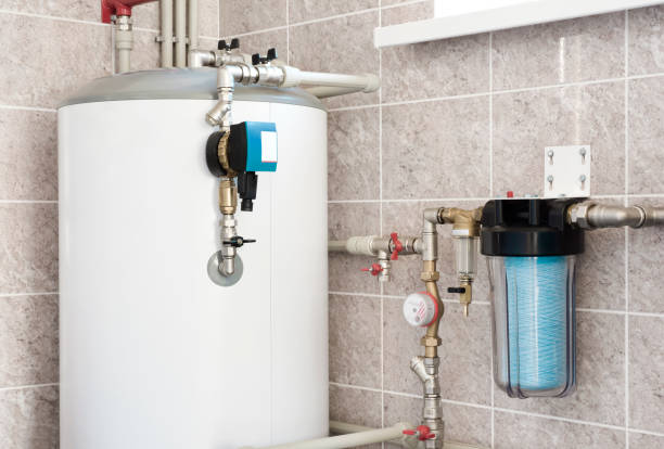 House water heating boiler with pump, ball valves and filters stock photo