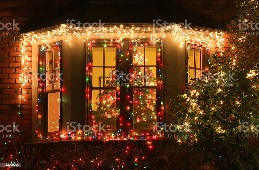 House window decorated with Christmas tree royalty-free stock photo