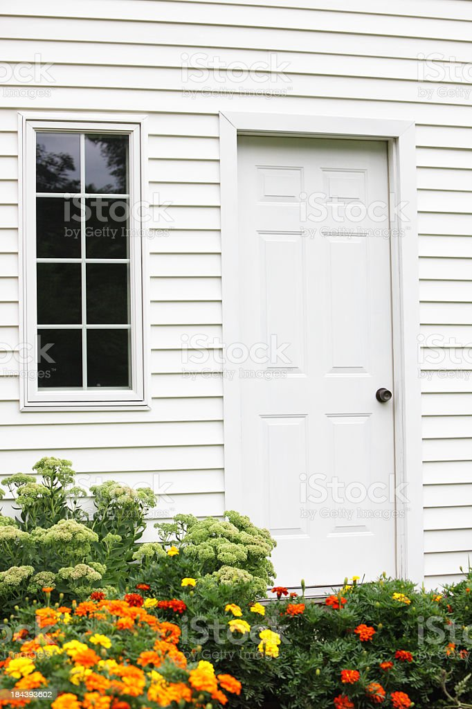 House Window, Door and Marigold Flowers royalty-free stock photo