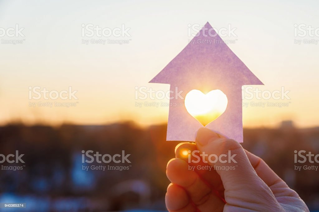 House with a carved heart on of sunrise. stock photo