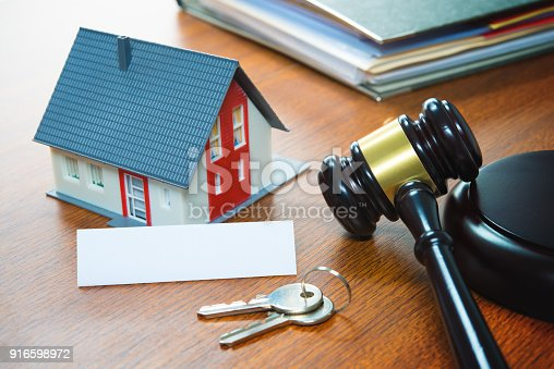 istock House with a Gavel. Foreclosure, real estate, sale, auction, business, buying 916598972