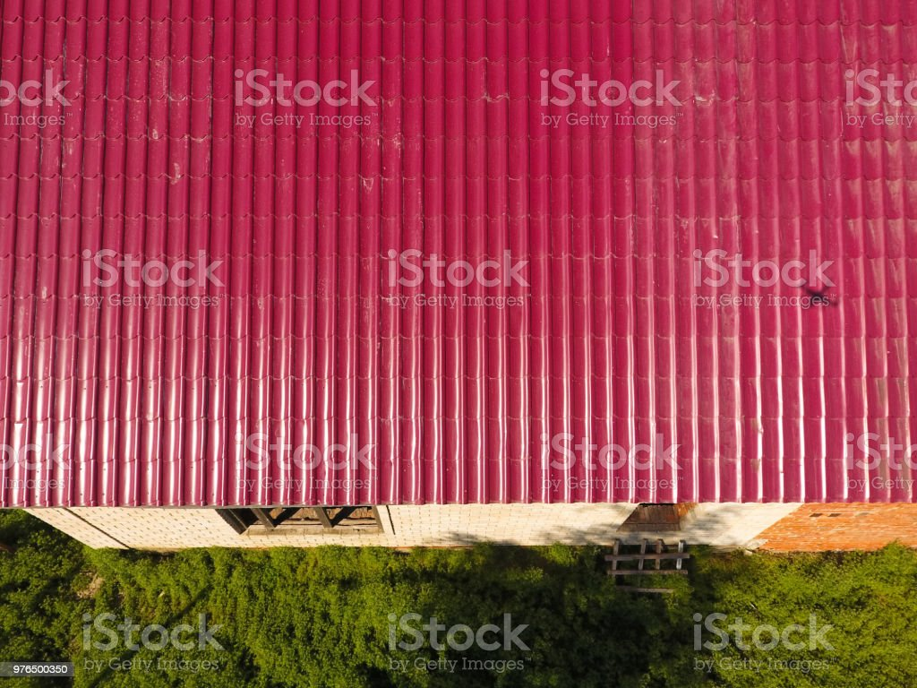 A House With A Red Roof Made Of Corrugated Metal Sheets Roof From ...
