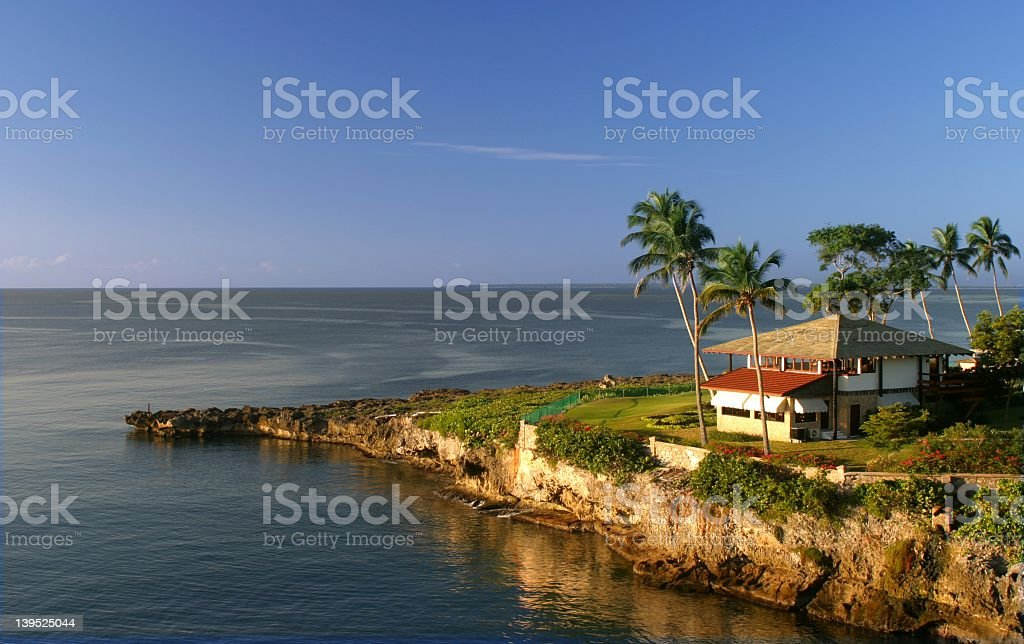 A house with an ocean view from a tropical coast stock photo