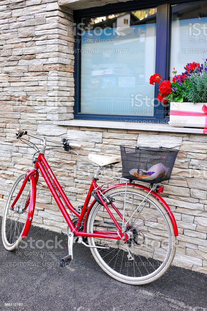House with bicycle at center Zermatt in Switzerland in CH royalty-free stock photo