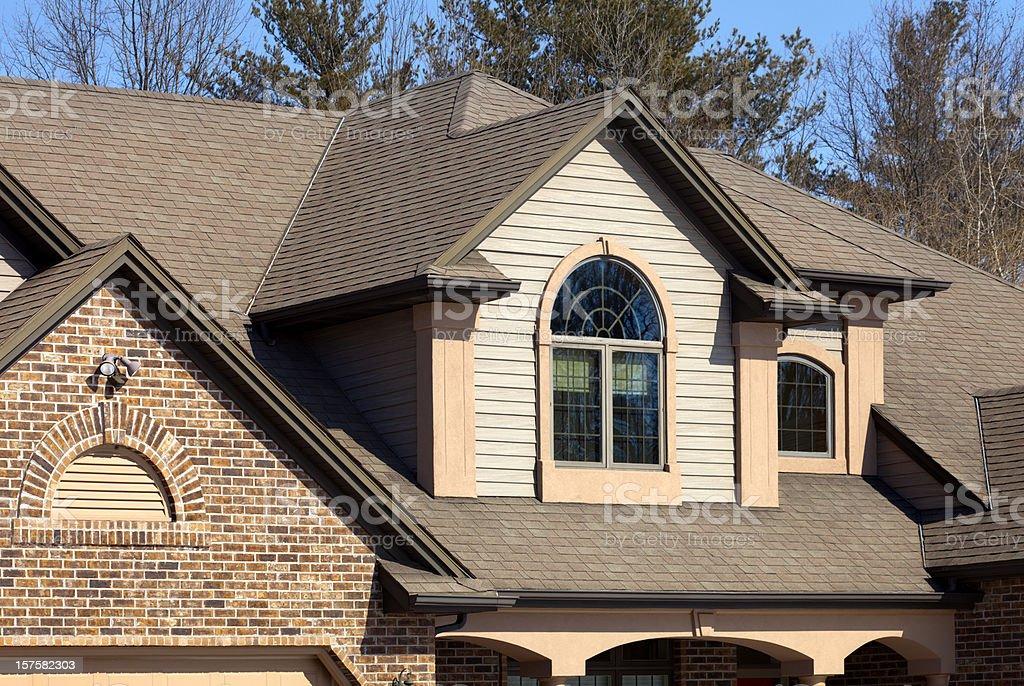 House With Brick Vinyl Siding Halfround Windows Stucco