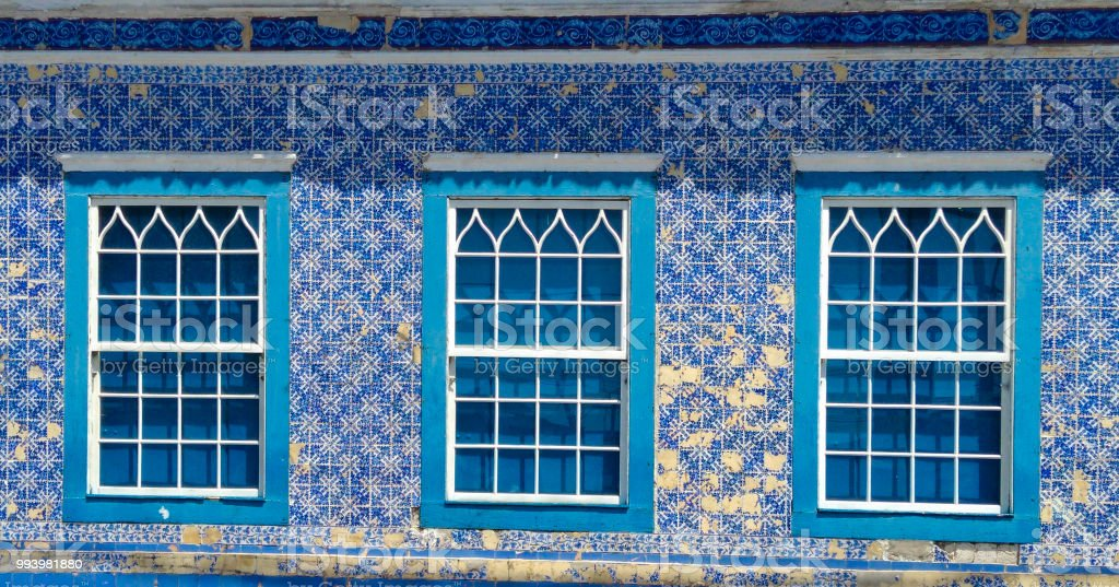 House with facade in tiles and windows stock photo