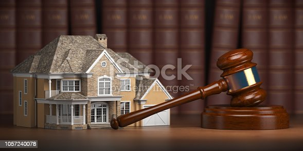 istock House with gavel and law books.  Real estate law and house auction concept 1057240078