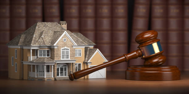 House with gavel and law books.  Real estate law and house auction concept stock photo