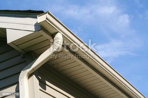 Angled view of gutter and downspout on a house