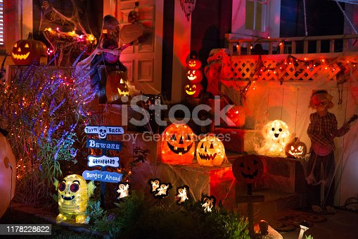 istock A house with Halloween pumpkins and halloween decorations at  Halloween night on a city street. Trick or treat. 1178228622
