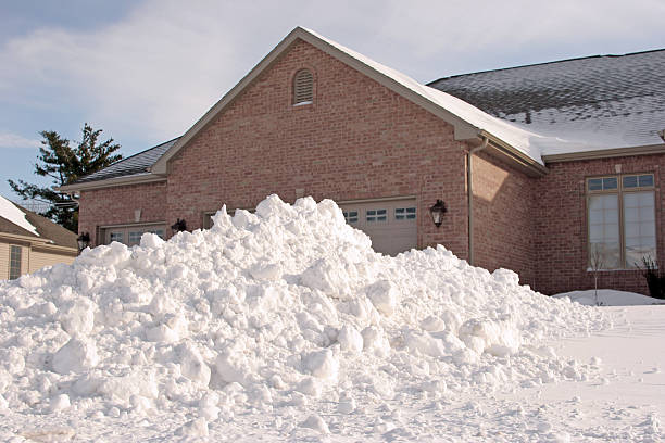 house with lots of snow - snow pile stock photos and pictures