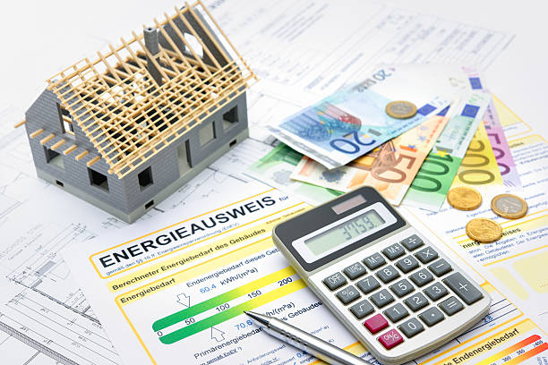 House with money and calculator stock photo