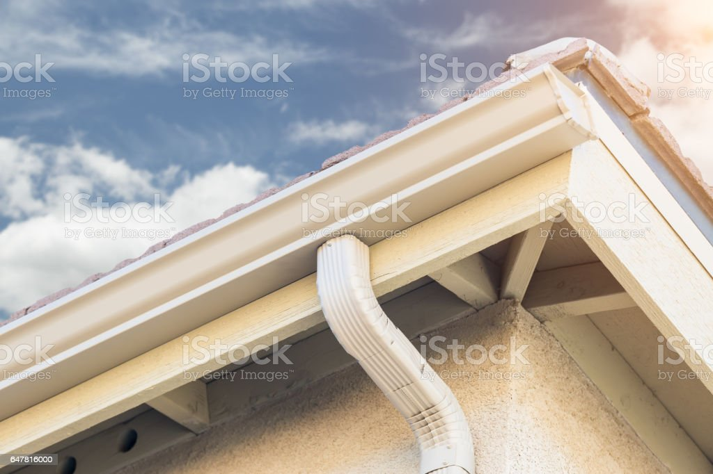 House with New Seamless Aluminum Rain Gutters. stock photo