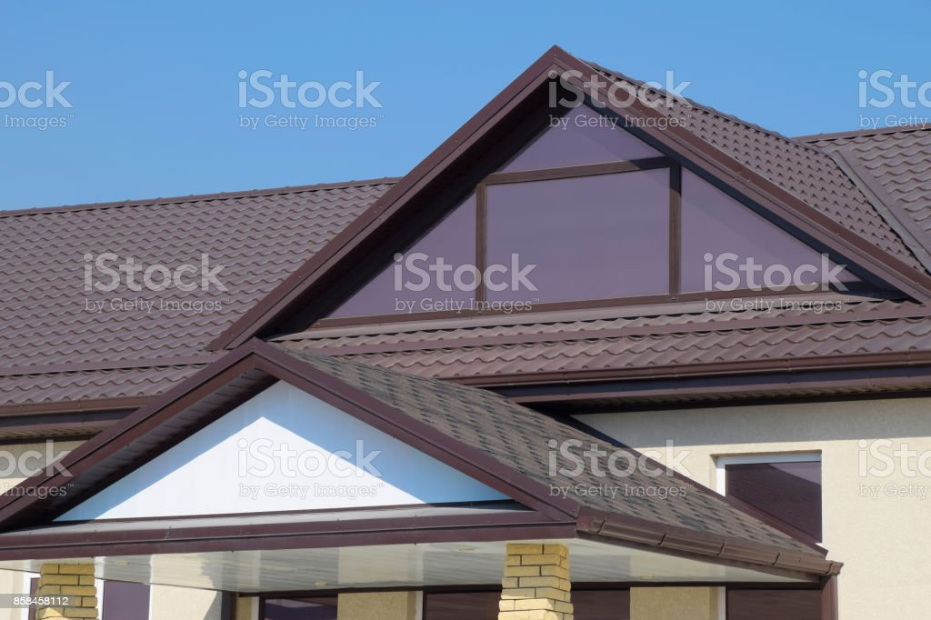 House with plastic windows and a brown roof of corrugated sheet stock photo